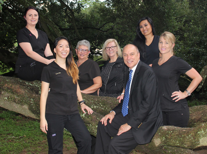 Outdoors photo of Baton Rouge dentist Dr. Steven Brooksher and his team.