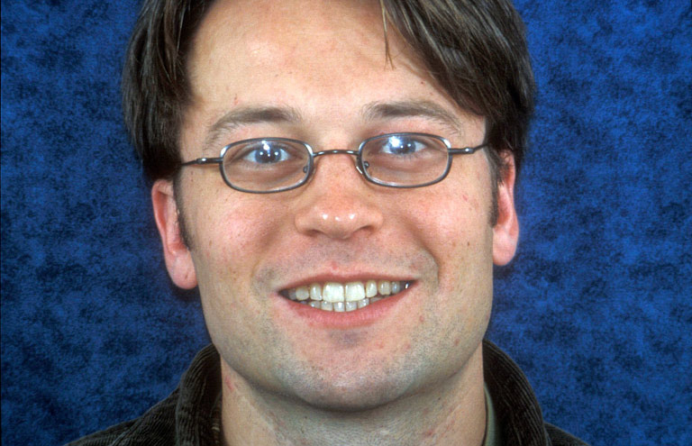 Headshot of Kurt smiling showing teeth before smile makeover