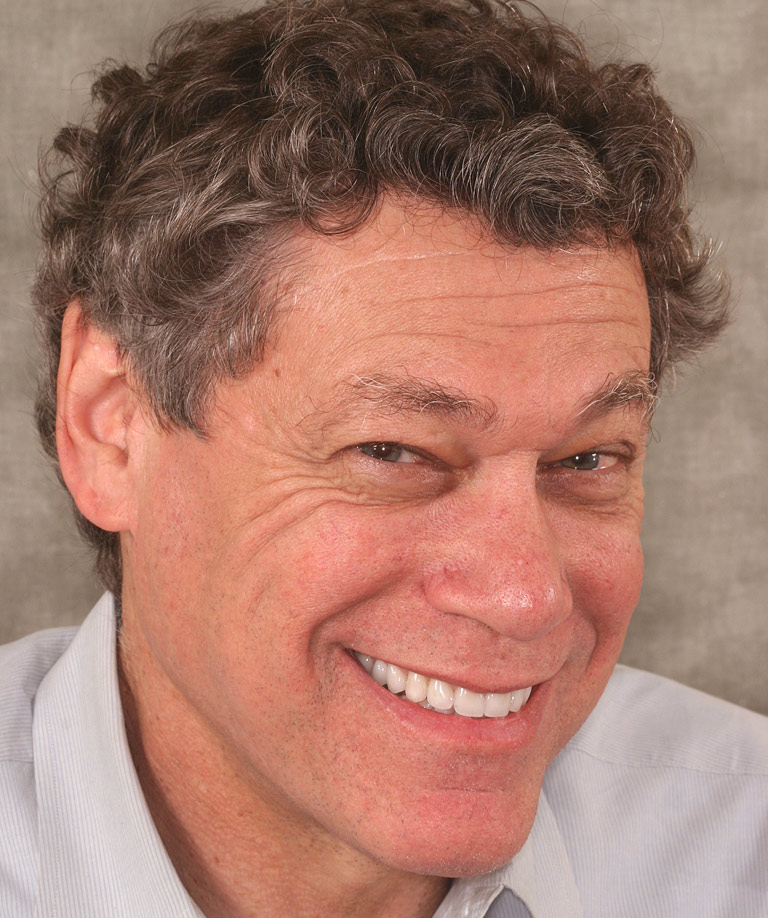 Headshot photo of Bob smiling showing smile makeover results from Dr. Brooksher
