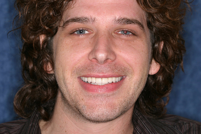 Headshot photo of Brent smiling after smile makeover
