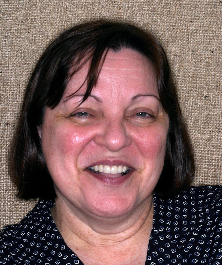 Headshot photo of Liz smiling showing smile makeover results from Dr. Brooksher