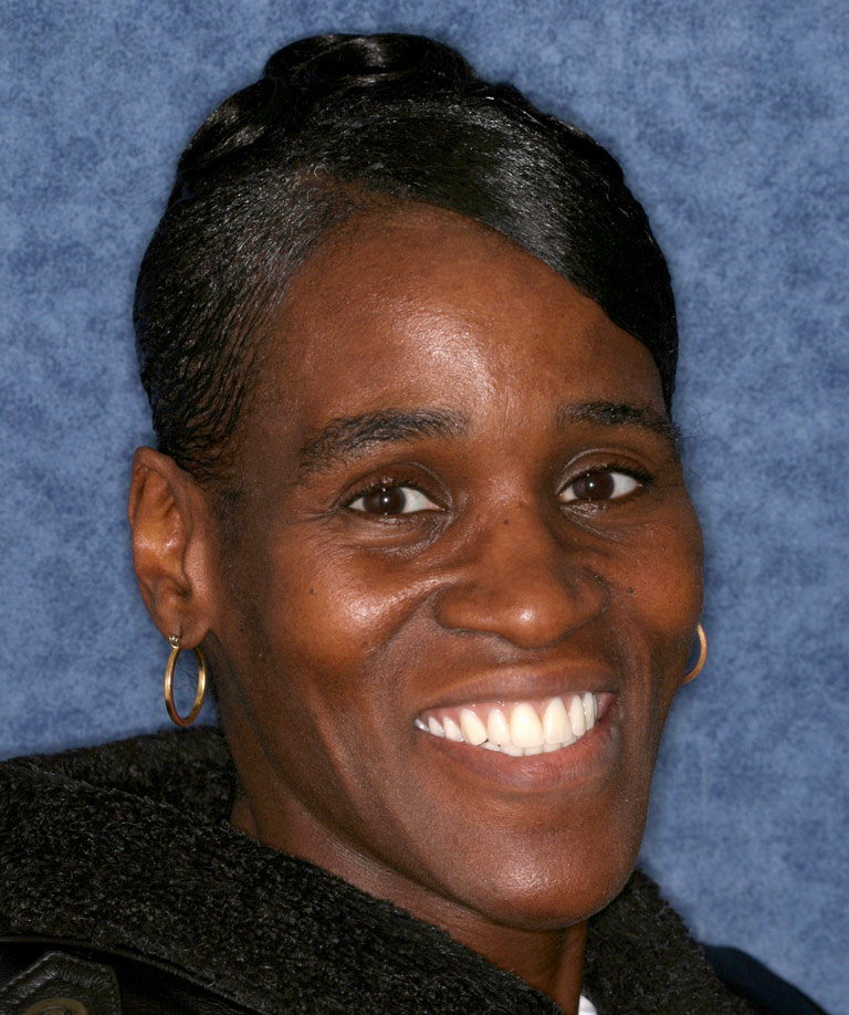 Headshot photo of Tracy smiling showing smile makeover results from Dr. Brooksher
