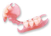 Picture of a partial denture witha plastic base and clasps